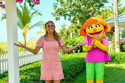 Activist and Actress Holly Robinson Peete enjoying Beaches Resorts during Autism Acceptance Month, alongside Sesame Street's Julia, a Muppet with a sensory disorder. Credit: Beaches Resorts