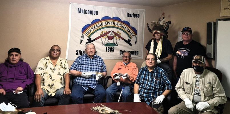 Lakota Elders, all with a family connection to Spotted Elk, accepting the Chief's pistol and knife.